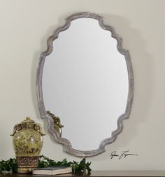 Uttermost Ludovica Mirror. Aged wood finish accented with a gray wash.