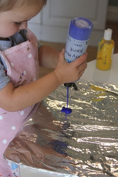 Preschoolers play with Van Gogh Style Finger-Paint Printing in this great activity from theimaginationtree.com.