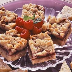 Raspberry Bars- Just made them using my homemade raspberry freezer jam and crushed almonds instead of pecans. Such a simple and delicious treat that includes the taste of fresh tart raspberries mixed with the flavor of buttery shortbread. Yum!