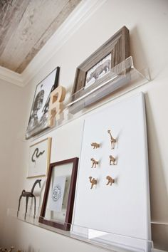 Pin for Later: How to Decorate a Designer-Worthy Nursery on a Budget  Floating acrylic shelves make switching up art and accessories a breeze.