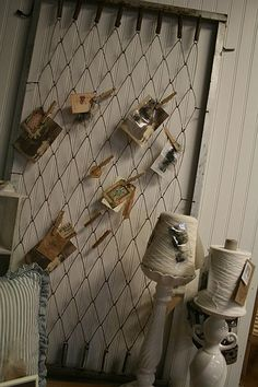 vintage photo display shabby baby bed spring and clothes pins