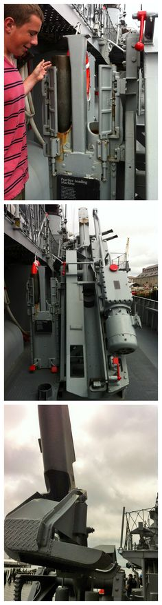 """Practice loading machine, USS Cassin Young. Author Sarah Sundin's son inspects the practice projectiles (top photo) These were loaded into practice loading machine (center) and popped out the chute shown on the rear once """"fired"""" (bottom). Charlestown Navy Yard, July 2014 (Photo: Sarah Sundin)"""