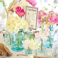 Small arrangements of pink peonies, sweet peas, and orchids topped the tables to create a fresh, just-picked look for the bridal shower!