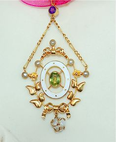 High carat gold pendant circa 1910 in symbolic colors of the suffragette movement. Green(peridot) for hope, purple(amethyst) for regal dignity and white(pearl & enamel) for purity.
