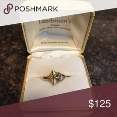 10K Tri-Color Gold Ring This is so pretty, the picture doesn't do it justice. Landstrom's Original Black Hills Gold Creations. This is in original box. It is pre-owned and in Excellent condition. I think it is about a size 5 but could be re-sized by any jeweler. 10K Tri-Color Gold. Beautiful and from a Smoke-Free Home. Landstrom's Jewelry Rings