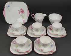 Lot 123, A Shelley Art Deco tea set with floral sprays comprising 5 tea cups, 5 saucers, a cream jug, sugar bowl, a sandwich plate and 5 small plates, est £50-100