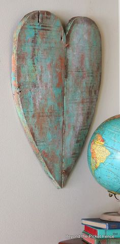 Reclaimed wood heart and a verdigris paint technique make for an interesting piece of art - via Beyond the Picket Fence