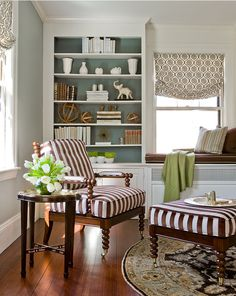 paint the inset of the bookshelves a contrasting color