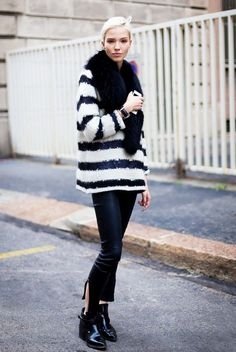 Striped sweater, black fur scarf, black cropped pants with slits and black ankle boots... - Street Style
