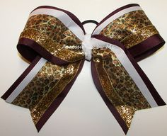 Big Cheer Bow Leopard Cheetah Metallic Maroon White Gold Girls Hair Accessory Cheerleader Competition Sports Football Spirit Bulk Discount by accessoriesbyme on Etsy https://www.etsy.com/listing/175069761/big-cheer-bow-leopard-cheetah-metallic