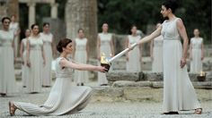 Greek performers light the Olympic Flame at the Temple of Hera in Greece.  No, this is not England - but the torch is now IN England, and will be there throughout the Summer Olympics of 2012.