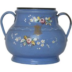 This stunning French enameled sugar bowl from the very early 1900s, is magnificently decorated by hand-painted rose floral stems, multi-hued leaves