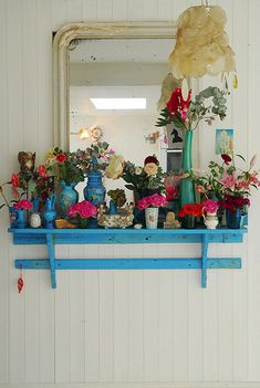 Lovely Turquoise shelf with pink roses and antique mirror
