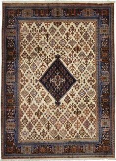 7' 1 x 9' 8 Yalameh Ivory Area Rug  Beautiful rug from Iran in the Yalameh design. Contains colors: Ivory, Blue, Brown, Green, Navy Blue, Orange, Rust Red