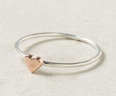 Wee heart ring: Less than 1/4-inch wide and made of both rose and white gold, this Anthropology ring is a fresh approach to the classic heart jewelry gift.