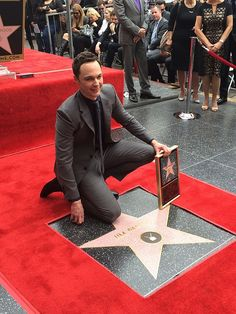 <em>The Big Bang Theory's </em>Jim Parsons (known to fans as Sheldon Cooper) is all smiles as he poses for photos with his star on the Hollywood Walk of Fame, March 11, 2015.