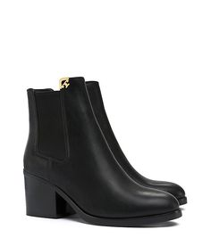 """Nicola Bootie in black - A true closet chameleon, delivers tomboyish good looks & hint of shine in a reliable goes-with-all style. This modern version of an ankle-grazing Chelsea boot is done in smooth waxed leather, w/variations that become richer w/wear, highlighting the quality of the grain. It features a split collar w/a metal 'T' corner plate. The silhouette is easy to slip on. 2.16"""" (6.5 cm) stacked block heel waxed leather upper elastic gores metal T napa leather lining leather sole"""