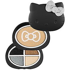 A three-tier luminizer and eye shadow palette shaped as Hello Kitty in glamorous matte black with a sparkling holiday bow.