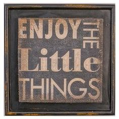 """Crafted from wood and burlap, this distressed wall decor offers a motivational message for your home office or kitchen.  Product: Wall decorConstruction Material: Wood and burlapColor: Distressed black frame Features: Typographic motif Dimensions: 8"""" H x 8"""" W"""