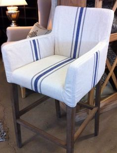 upholstered counter height chair... love the crisp fabric with blue stripes against the dark wood stained legs.