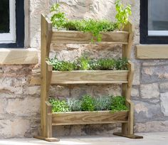 A great way to expand your kitchen garden, this Vertical Garden Herb Stand contains three generous vertical planters in a compact wooden frame. Vertical Pallet Garden, Herb Garden Pallet, Vertical Planter, Herb Planters, Raised Planter, Wooden Planters, Pallets Garden, Vegetable Garden, Verticle Herb Garden