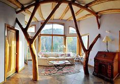 Earthship Spain - I'd love to use trees like this to create spaces or points of interest in side.. think of the holiday decorating possibilities with these trees as part of the structure!!