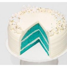 """One of """"Oprah's Favorite Things""""! A moist """"blue"""" vanilla cake with cream cheese filling and topping, decorated with delicate sugar snowflakes and silver beads."""