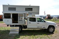 Introducing the Four Wheel Camper Fleet Flatbed self-contained with a face-to-face dinette and side entry on a Toyota Tacoma. Truck Camper, Camper Trailers, Camper Van, Travel Trailers, Converted Bus, Truck Bed Camping, Cool Campers, Toyota Trucks, Expedition Vehicle