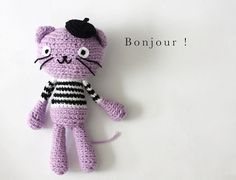 | Purple Crocheted Amigurumi Cat in Black & White Striped Top with Black ...  this doesn't lead anywhere I just like the cat to maybe try on my own.