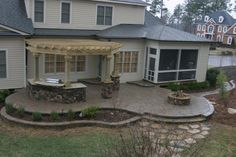 Like the raised patio with plantings - Triangle Co