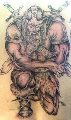 Strong viking warrior kneeling tattoo
