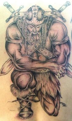 Strong viking warrior kneeling tattoo