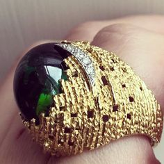 A yellow gold textured wire cabochon green tourmaline and diamond ring by Andrew Grima 1968 | for more information: info@grimajewellery.com