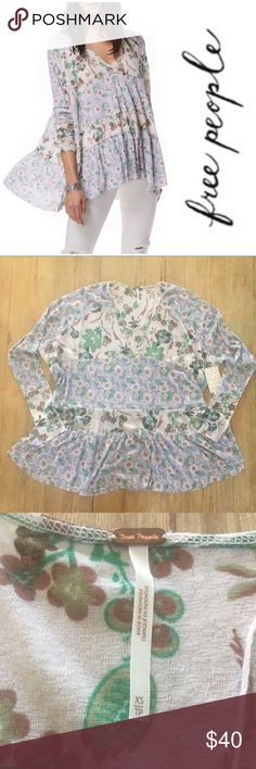 "NWT.  Free People Isabelle tunic. Brand new with tags.  Free People Isabelle tunic.  Size xs.  This  runs big so would likely fit a size S or even m.    Slight high / low hem.  Shortest length is approx 27"".  Longest length is approx 30"".   Made of 100% polyester. Free People Tops"