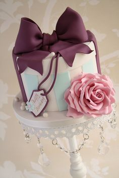 Plum bow & pink flower -- cake portfolio 1323 by Cotton and Crumbs, via Flickr