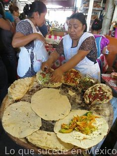 Tlayudas oaxaqueñas  Their aprons remind me of my grandma and aunt's when they were cooking :)