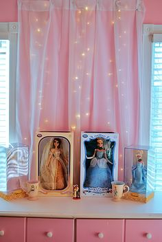 Love this idea for a girls room. Sheer curtains between two windows with christmas lights behind it. Very cute