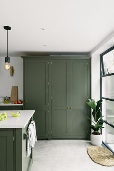 10 Beautiful Rooms - Mad About The House 10 Beautiful Rooms: olive green kitchen by Devol Green Kitchen Cabinets, Farmhouse Kitchen Cabinets, Kitchen Paint, Painted Kitchen Cupboards, Painted Fridge, Green Kitchen Island, Kitchen Units, Kitchen Nook, Devol Shaker Kitchen