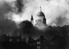 St Paul's Cathedral, rising above the bombed London skyline, is shrouded in smoke during the Blitz. The photograph was taken from the roof of the Daily Mail offices in Fleet Street. Christopher Wren, London In December, 29 December, The Blitz, Fleet Street, Air Raid, London Skyline, Battle Of Britain, History Channel