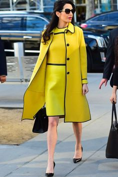 Amal Clooney styling Bottega Veneta in our favorite spring-inspired color of the moment.