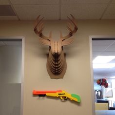 Nerf gun on the wall, this definitely looks like DragonSearch! #usdragons