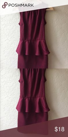 Burgundy maroon red peplum dress from H&M Form fitting, classy, peplum style dress. Sits above the knees. Size 2 but fits like a 0 H&M Dresses