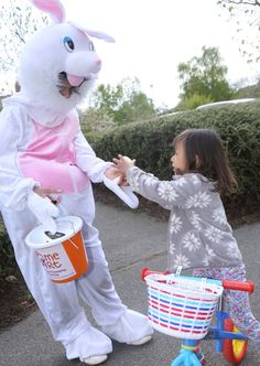 The Easter Bunny helps Helena Penn, three, collect beans in order to get a chocolate egg. PICTURE: Seana Hughes