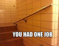 This railing is only effective for really tall people who get hit with a shrinking ray as they walk up the stairs.