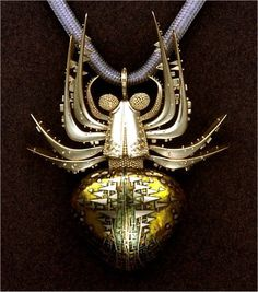 Frightening but beautiful, I may need to make a new spot for jewels.John Paul Miller, Silver Spider, 18k gold, enamel