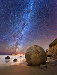 The Moeraki Boulders are unusually large and spherical boulders lying along a stretch of Koekohe Beach, South Island, New Zealand