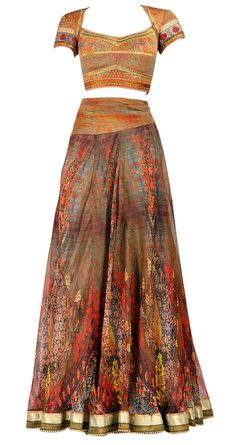 Digital dressing! This printed silk organza lehenga by the talented Tarun Tahiliani comes with a brocade blouse with crystal work and a shaded net dupatta.