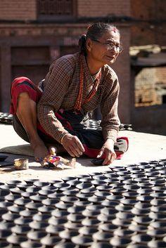 陶工婆婆 / Pottery maker, Potters' Square, Bhaktapur, Nepal by randomix, via Flickr