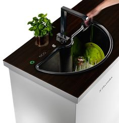 Besides being a space-saving idea, the washing technique is eco-sensitive as well; it functions using only the minimal resources required, based on the space occupied by the dishes in the chamber. There is a cycle for washing fruits and vegetables included as well. What a perfect sink!    Designer: AHHA Project