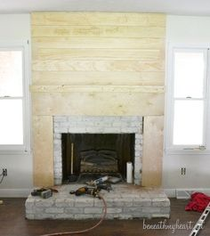 diy fireplace surround plans how to create a fireplace surround diy electric fireplace surround plans Fireplace Cover Up, Fireplace Surround Diy, Wood Fireplace Surrounds, Build A Fireplace, Fireplace Update, Brick Fireplace Makeover, Farmhouse Fireplace, Fireplace Mantle, Fireplace Design